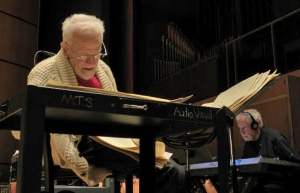 Gerry checks his music score while Dave Grusin prepares a keyboard coloration for the score.