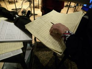 Gerry Fried checking his music manuscript.