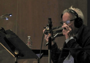 Legendary harmonica player Tommy Morgan rehearses with his bass harmonica.
